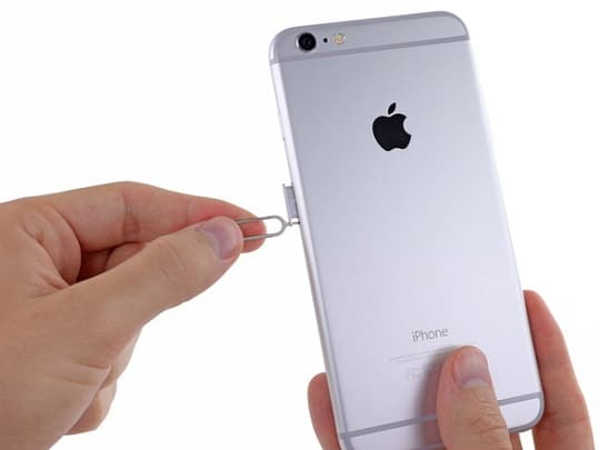 Reinstall the SIM card to fix iPhone Keeps Dropping Calls